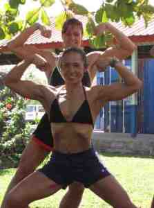 Viola Timoteo-Etuata (front) and Deborah Tafili Wilson flexing for SPG