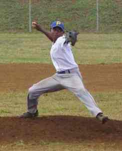 Kalson Dulei winds up for a pitch as he shuts down American Samoa's offense, limiting them to one run in seven innings
