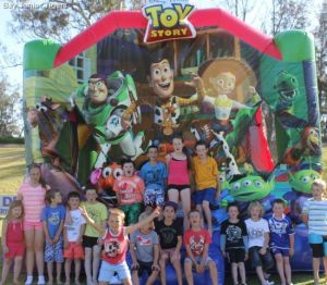 Kids in front of Toy Story 3 Jumping Castle