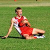 Young Coffs Swans player Jake Brown dives to take a safe chest mark. Photo: Matt McInerney/Daily Examiner