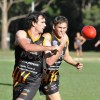 Mark Cowland gets a hanball away to a Grafton teammate. Photo: Matt McInerney/Daily Examiner
