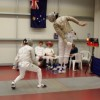 Tim Davis showing his Epee Team mates how it is done