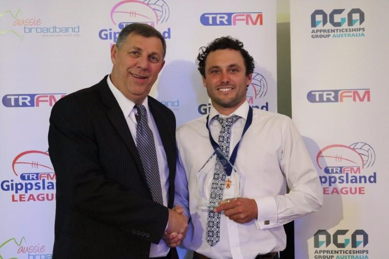 TRFM Gippsland League chair Greg Maidment with Trood Award and Rodda medallist Brad Scalzo of Warragul