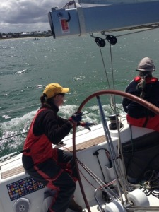 Sue Bumstead on the helm of Beneteau 40 Dry White